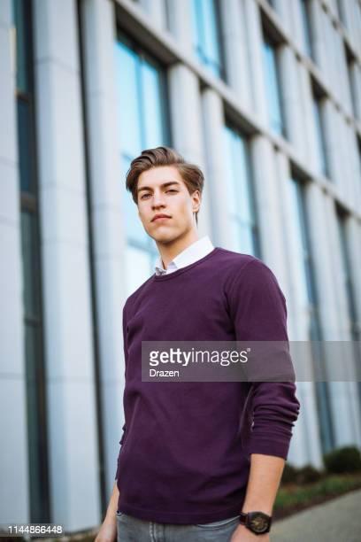 millennial student near office building. - casual chique imagens e fotografias de stock