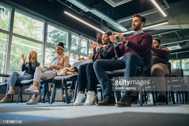 millennial team at board meeting - south_agency stock pictures, royalty-free photos & images