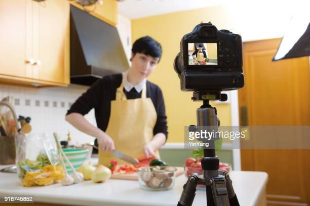 Millennial Vlogging Video Blogging Cooking Tutorial Demonstration in Home Kitchen
