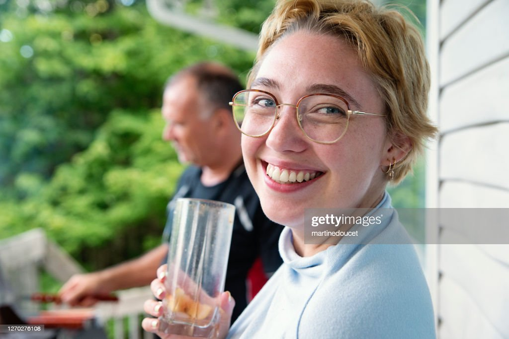 Millennial woman and senior man with barbecue in country house. : Stock Photo