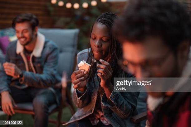 Millennial woman eating s'mores