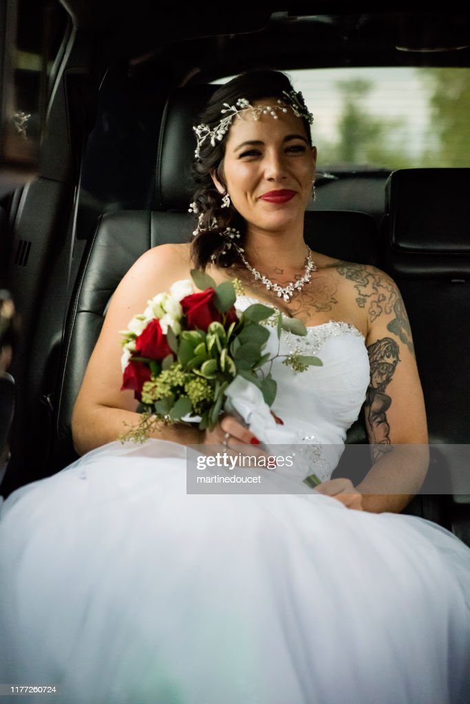 Millennial woman in limousine on her way to wedding. : Stock Photo