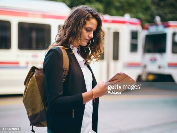 millennial woman in urban city environment - salt lake city utah stock pictures, royalty-free photos & images