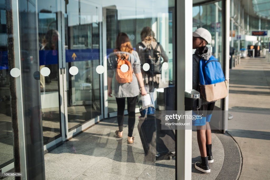 Millennial woman traveling in airport. : Stock Photo
