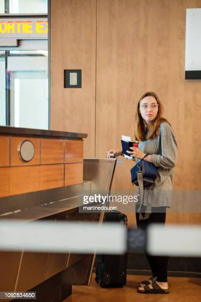 Millennial woman traveling in airport.