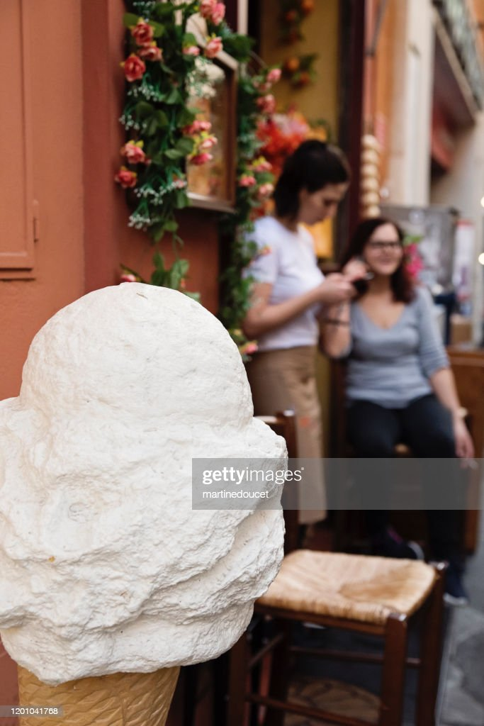 Millennial women and gelato store in Bologna, Italy. : Stock Photo