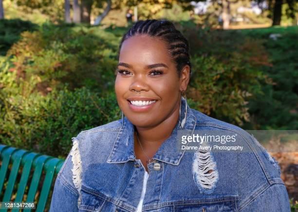 millennial young black woman with cornrow braids - コーンロウ ストックフォトと画像