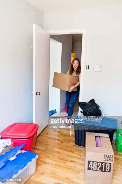Millennial young woman moving in new apartment.
