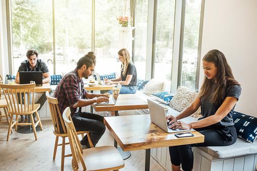 Millennials at wifi cafe 1060887310