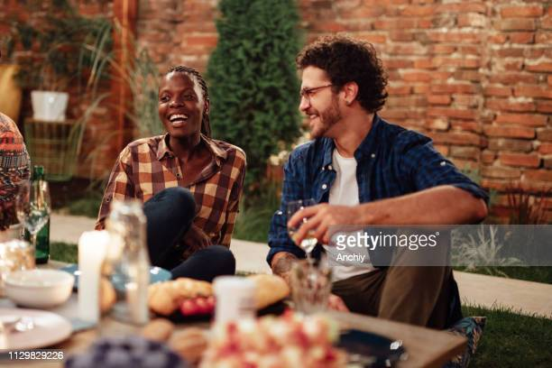 millennials enjoying dinner in outdoor restaurant - outdoor dining stock pictures, royalty-free photos & images