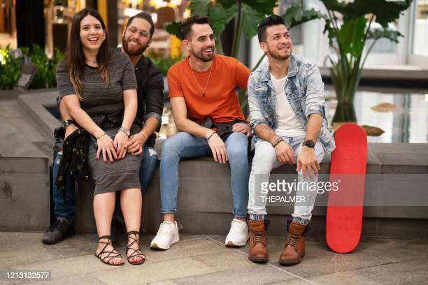 millennials friends hanging out - puerto rican ethnicity stock pictures, royalty-free photos & images