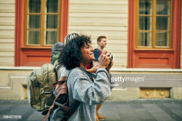 millennial's friends visit foreign city - photographing stock pictures, royalty-free photos & images
