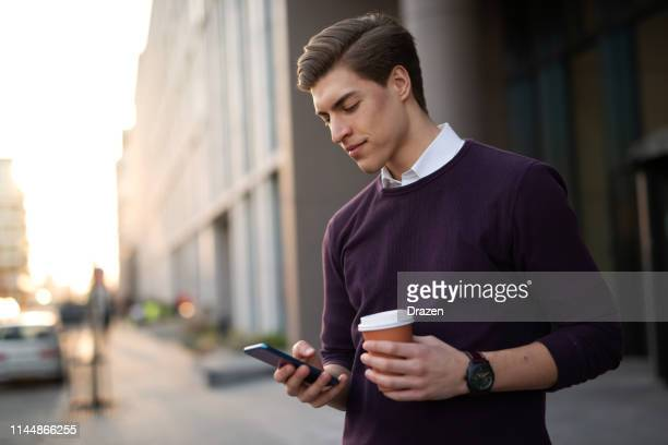 millennials using mobile apps an online financial services. - money transfer stock pictures, royalty-free photos & images