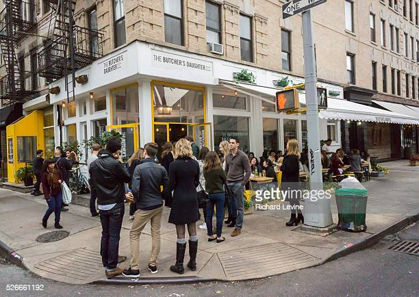 Millennials wait to be seated for brunch outside the Butcher's Daughter restaurant in the Nolita neighborhood of New York on Saturday December 12 2015
