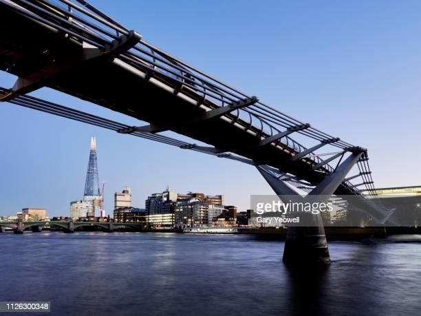 millennium bridge and shard in london - テムズ川 ストックフォトと画像