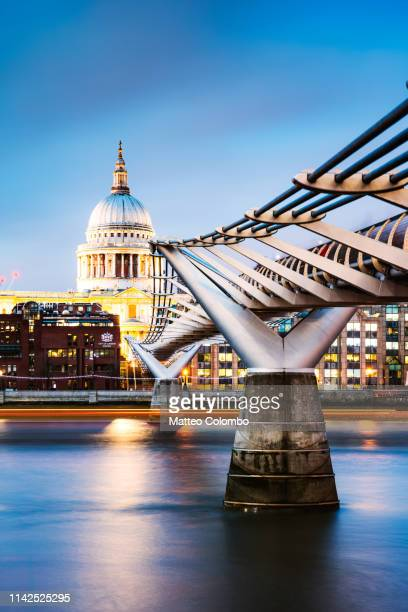 millennium bridge and st paul's cathedral at dusk, london - st. paul's cathedral london stock pictures, royalty-free photos & images
