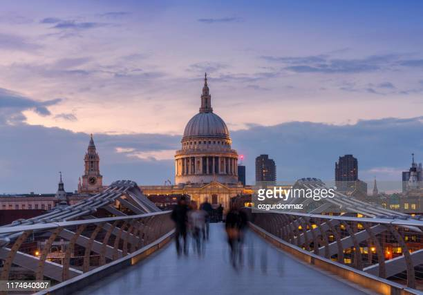 millennium bridge and st. paul's cathedral with commuters at dusk - pedestrian stock pictures, royalty-free photos & images