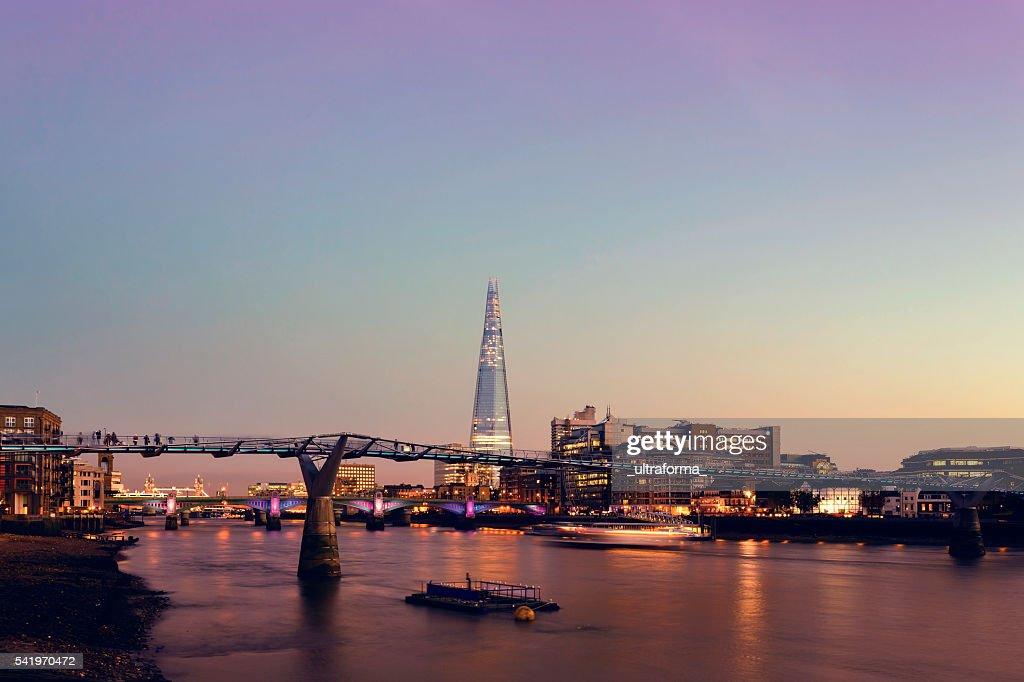 Millennium Bridge and The Shard in London at twilight : Stock Photo