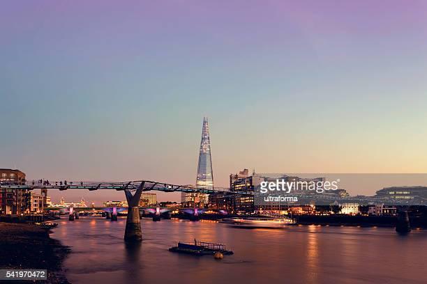 Millennium Bridge and The Shard in London at twilight