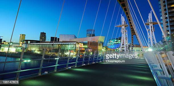 millennium bridge, salford quays, manchester - salford stock pictures, royalty-free photos & images