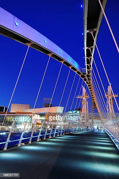 millennium bridge, salford quays, manchester - manchester england stock photos and pictures
