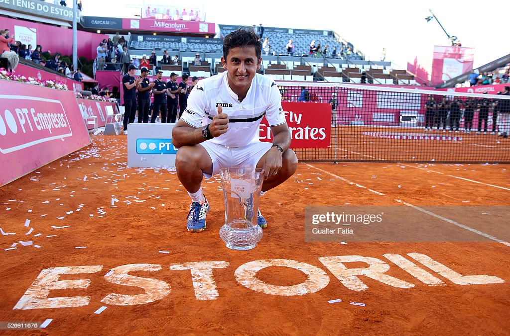 Millennium Estoril Open 2016's winner Nicolas Almagro from Spain pose for photo with trophy at the end of the singles final match between Pablo Carreno Busta from Spain and Nicolas Almagro from Spain for Millennium Estoril Open at Clube de Tenis do Estoril on May 1, 2016 in Estoril, Portugal.