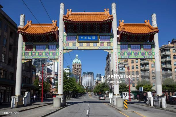 millennium gate, chinatown, vancouver, british columbia province, canada - chinatown stock pictures, royalty-free photos & images