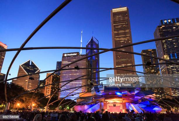 Millennium Park crowd at Grant Park Symphony the Jay Pritzker Pavilion a band shell designed by Frank Gehry skyscrapers of the downtown on the...