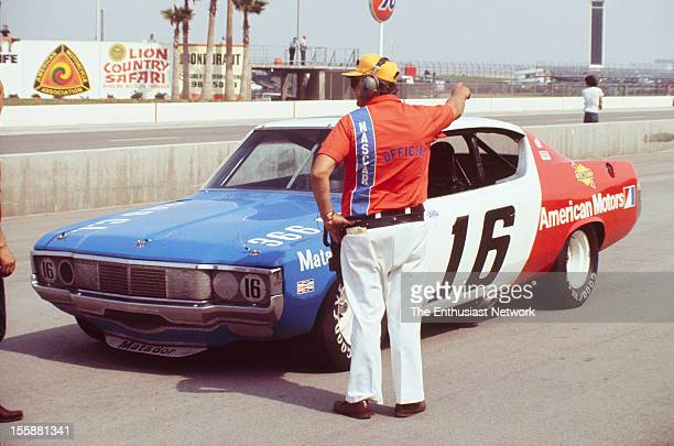 Miller 500 NASCAR Ontario Motor Speedway A NASCAR race official stands by the AMC Matador of Mark Donohue in pit lane