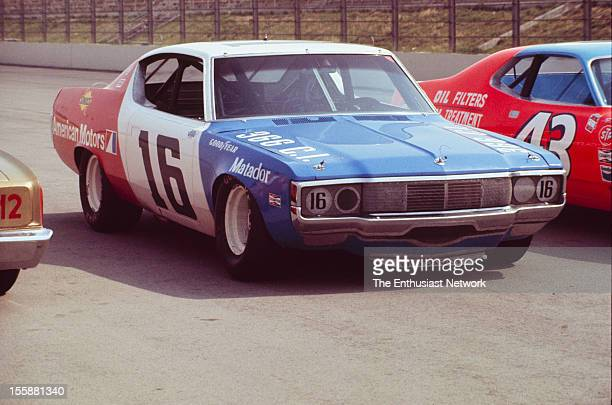 Miller 500 NASCAR Ontario Motor Speedway Mark Donohue of Penske racing AMC Matador sits parked on track between the car of Richard Petty and Bobby...