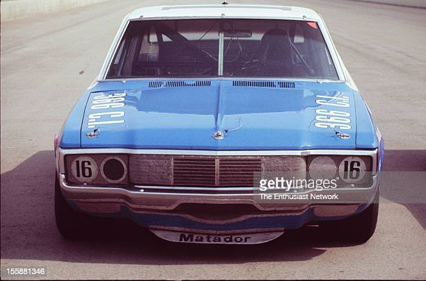Miller 500 NASCAR Ontario Motor Speedway Mark Donohue of Penske racing AMC Matador sits by the paddock Donohue would start the race seventh on the...