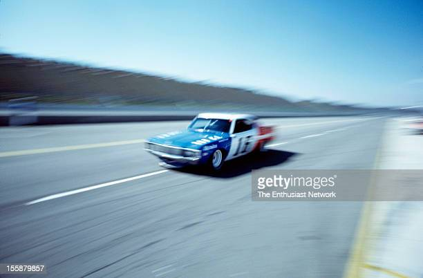 Miller 500 NASCAR Ontario Motor Speedway Mark Donohue of Penske Racing driving his AMC Matador to empty grand stands The photo was part of a Hot Rod...