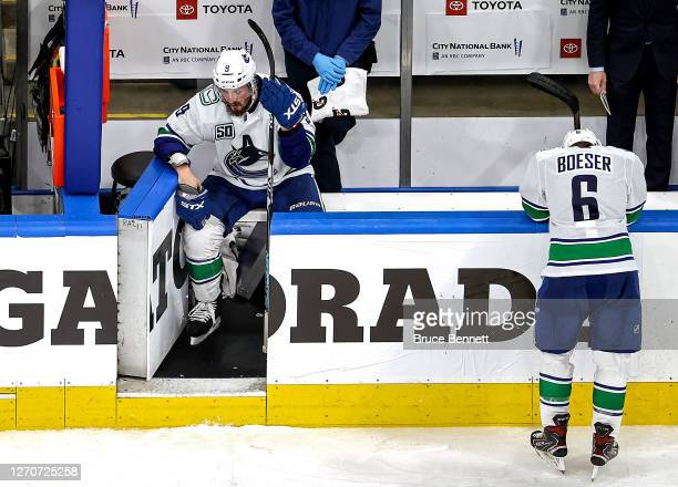 Miller and Brock Boeser of the Vancouver Canucks react to their teams deficit to the Vegas Golden Knights late in the third period in Game Seven of...