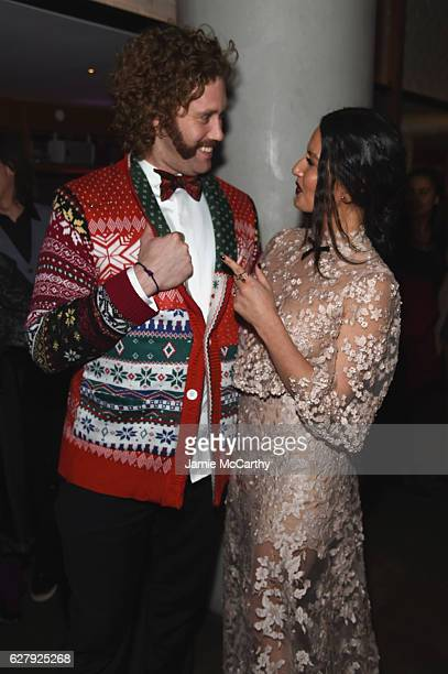 T J Miller and Olivia Munn attend the Paramount Pictures with The Cinema Society Svedka Host An After Party For 'Office Christmas Party' at Mr Purple...