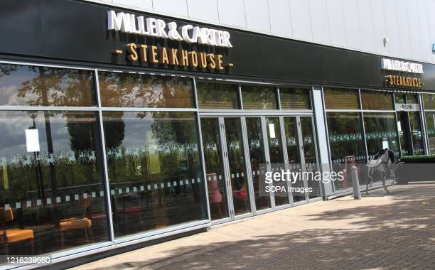 Miller & Carter Steakhouse logo seen at one of their branches. UK Government has announced that a number of non-essential retail enterprises such as...