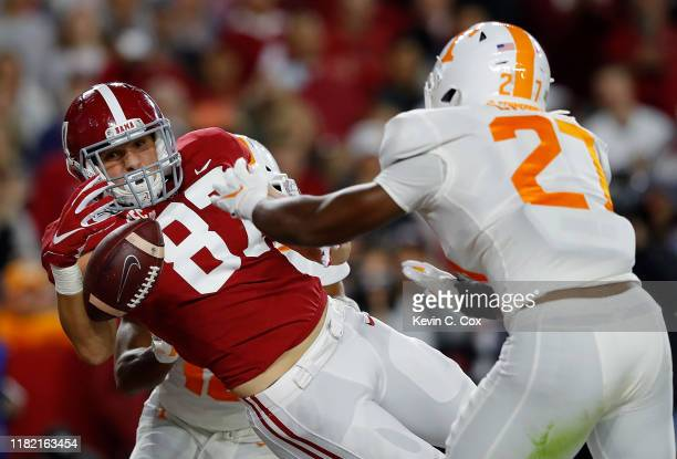 Miller Forristall of the Alabama Crimson Tide fails to pull in this touchdown reception against Quavaris Crouch and Nigel Warrior of the Tennessee...