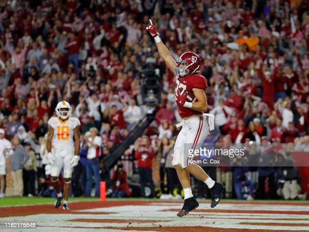 Miller Forristall of the Alabama Crimson Tide reacts after pulling in this touchdown reception against the Tennessee Volunteers in the second half at...
