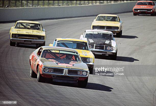 Miller High Life 500 Ontario Motor Speedway Bobby Allison in his '70 CocaCola Dodge the group coming into the corner