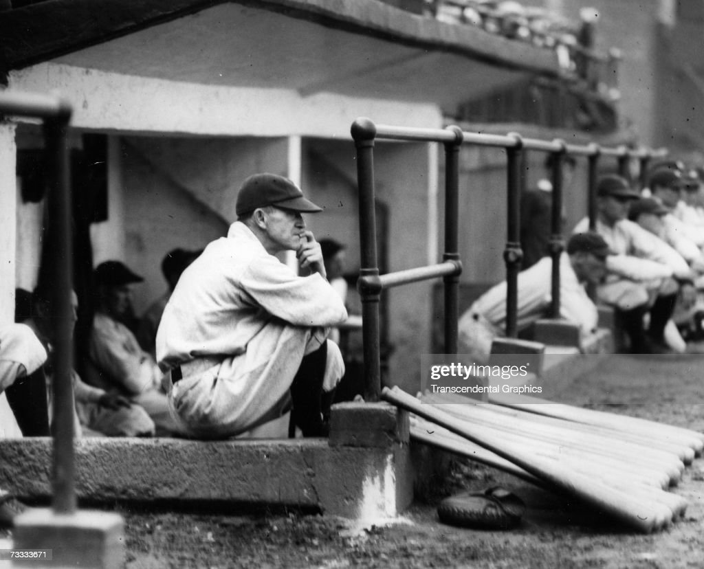 NEW YORK - AUGUST, 7, 1928. Miller Huggins, manager of the New York Yankees, contemplates the game action in Yankee Stadium on August 7, 1928.