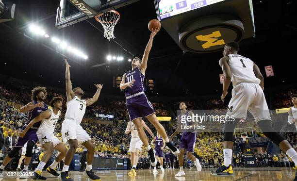 Miller Kopp of the Northwestern Wildcats drives the ball to the basket during the first half of the game against the Michigan Wolverines at Crisler...