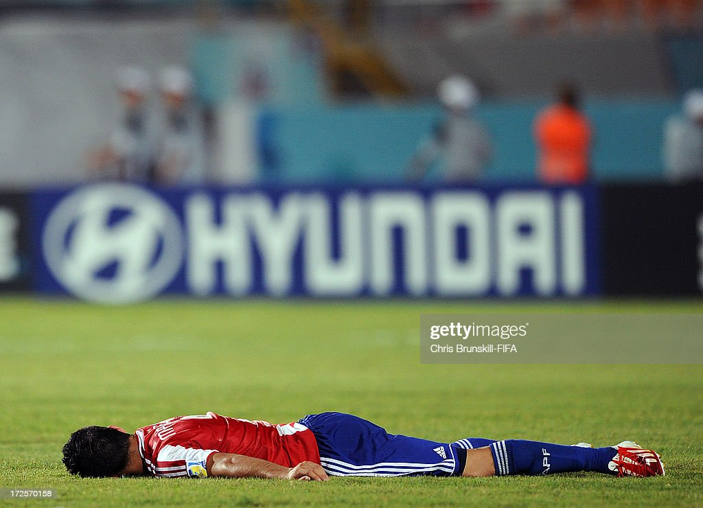 Miller Mareco of Paraguay lies dejected at full-time following during the FIFA U20 World Cup Round of 16 match between Iraq and Paraguay at Akdeniz University Stadium on July 03, 2013 in Antalya, Turkey.