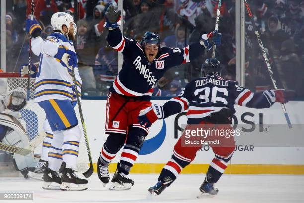 T Miller of the New York Rangers celebrates his gamewinning goal in overtime against the Buffalo Sabres with teammate Mats Zuccarello during the 2018...
