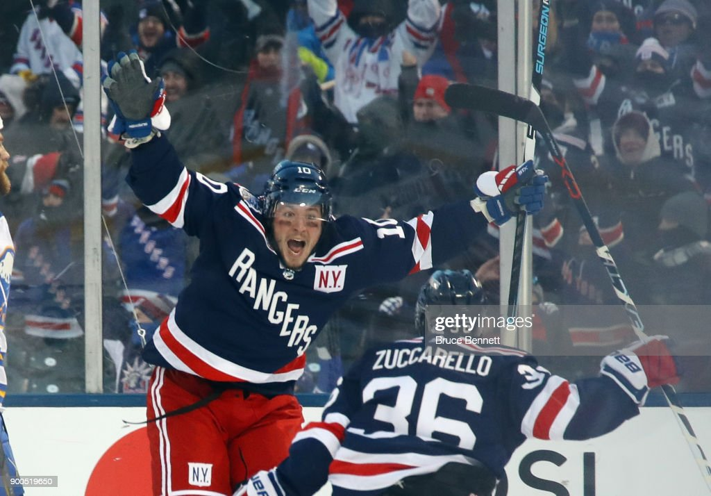 J.T. Miller #10 of the New York Rangers celebrates his game-winning goal in overtime against the Buffalo Sabres with teammate Mats Zuccarello #36 during the 2018 Bridgestone NHL Winter Classic at Citi Field on January 1, 2018 in the Flushing neighborhood of the Queens borough of New York City.