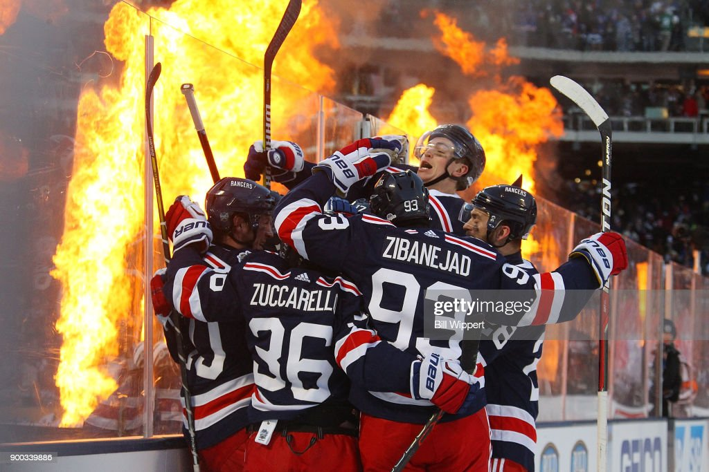 J.T. Miller #10 of the New York Rangers celebrates his game-winning overtime goal against the Buffalo Sabres during the 2018 Bridgestone NHL Winter Classic at Citi Field on January 1, 2018 in New York, New York. The Rangers won, 3-2.