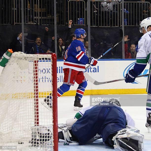 T Miller of the New York Rangers celebrates his overtime goal against Ryan Miller of the Vancouver Canucks at Madison Square Garden on January 19...