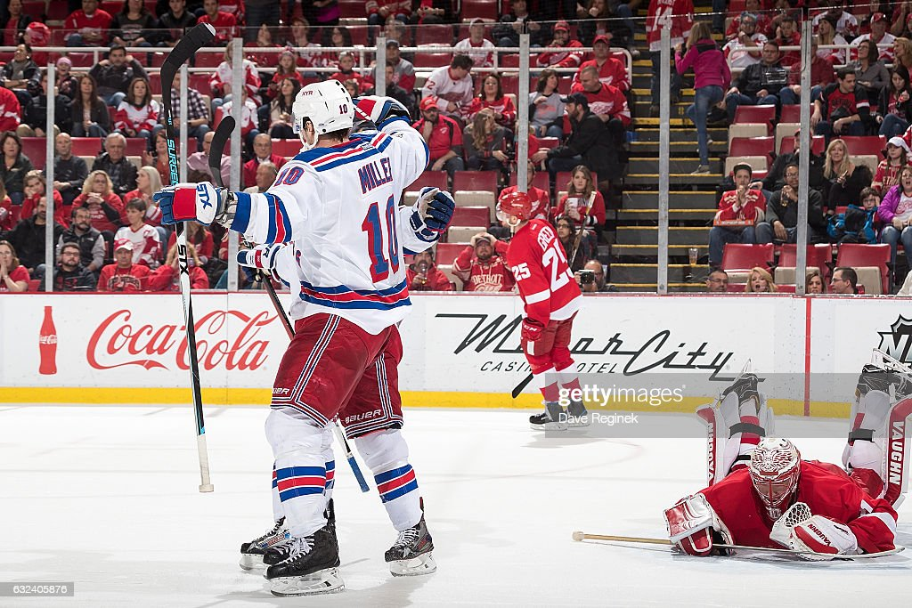 J.T. Miller #10 of the New York Rangers celebrates his overtime goal in front of goaltender Jared Coreau #31 of the Detroit Red Wings during an NHL game at Joe Louis Arena on January 22, 2017 in Detroit, Michigan. The Rangers defeated the Wings 1-0 in overtime.
