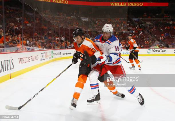 T Miller of the New York Rangers knocks Samuel Morin of the Philadelphia Flyers off the puck during the first period during a preseason game at the...