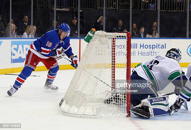 T Miller of the New York Rangers scores the game winning goal against Ryan Miller of the Vancouver Canucks at 354 of overtime at Madison Square...