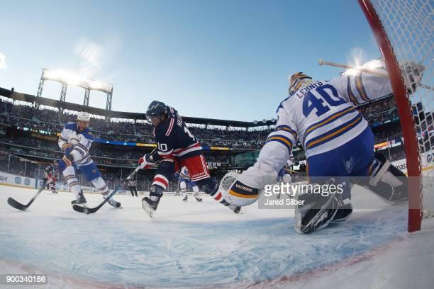 T Miller of the New York Rangers shoots the game winning goal in overtime on Robin Lehner of the Buffalo Sabres during the 2018 Bridgestone NHL...