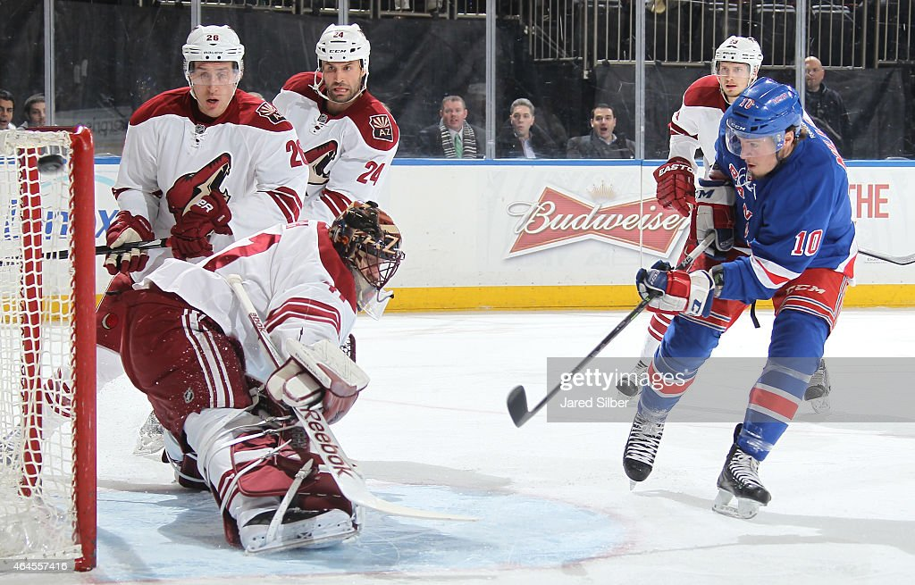 J.T. Miller #10 of the New York Rangers shoots the puck wide of the net against Mike Smith #41 of the Arizona Coyotes at Madison Square Garden on February 26, 2015 in New York City.